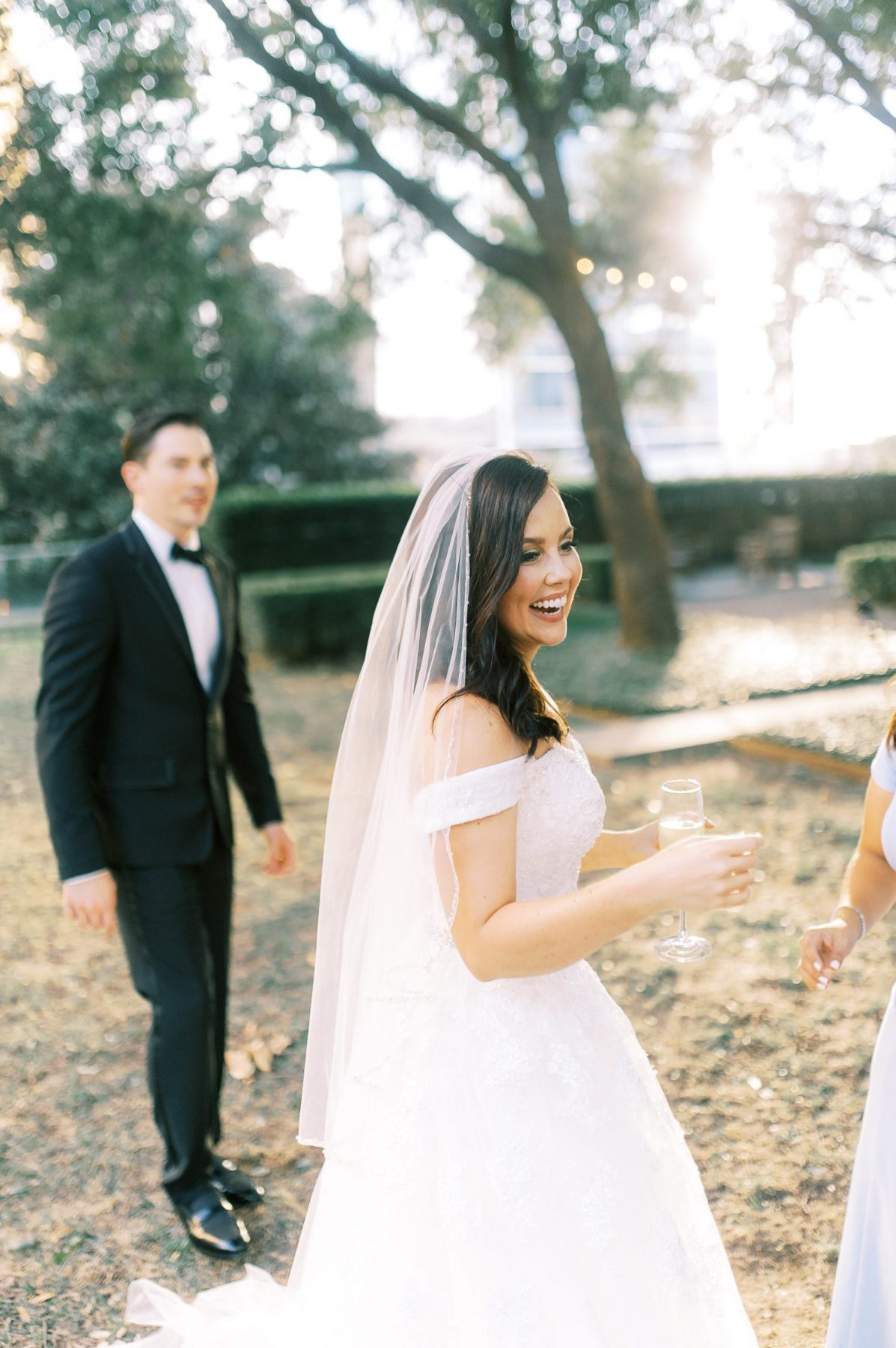 Bride and Groom having a glass of Champagne at Marie Gabrielle Garden Wedding Venue