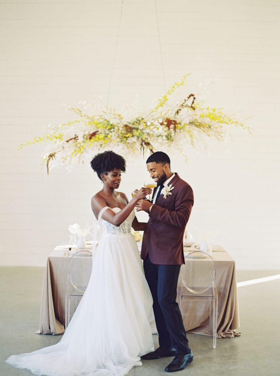 Couple Having a toast at Prospect House Wedding Venue in Austin, Texas