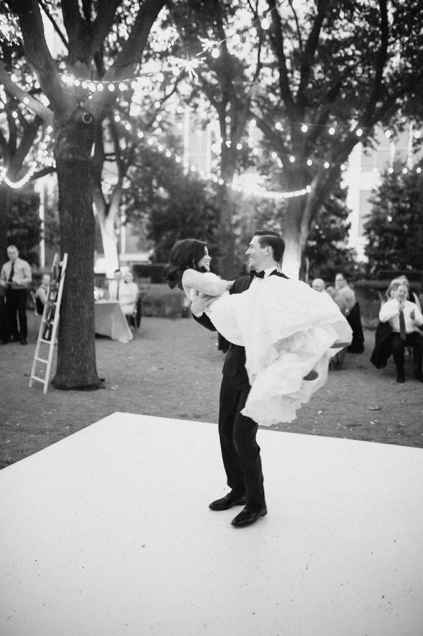 Black and white portrait of Bride and Groom dancing at Marie Gabrielle Garden Wedding Venue in Dallas, Texas.