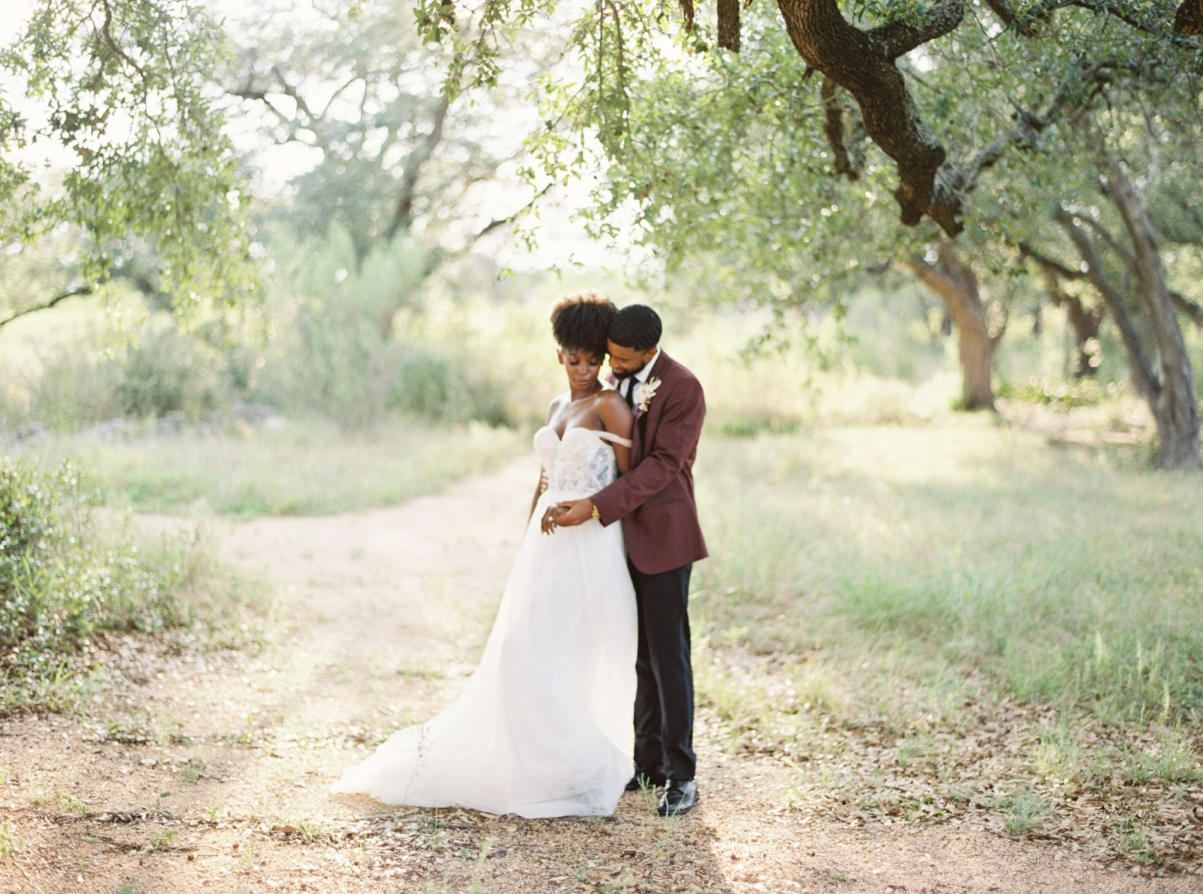 Bride and Groom embracing under oak tree at Prospect House Wedding Venue